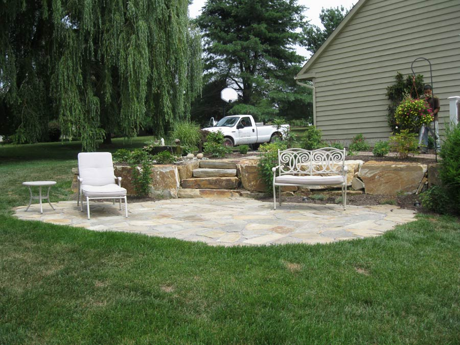 Custom hardscape stonework and masonry designs for Custom backyard designs